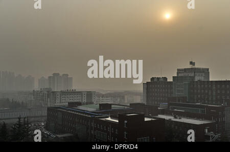 Beijing, China. 16th Jan, 2014. Buildings are blanketed in heavy smog in Beijing, capital of China, 16, 2014. The - Stock Photo