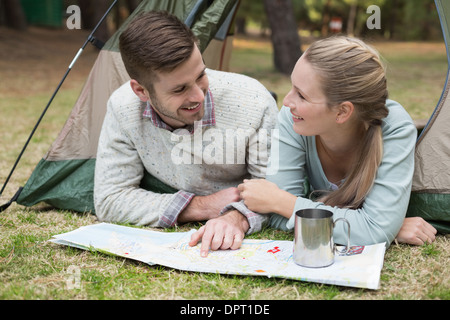 Young couple camping in the wilderness - Stock Photo