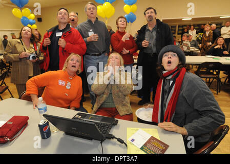 From bottom left, Nancy Dommes, Sharon Burke and Sally McDaniel, all of Alamo,  look at unfavorable early results - Stock Photo