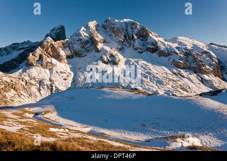 Looking across fresh autumn snow towards Monte Cernera (2657m), above the Giau Pass, Dolomites, Italy. - Stock Photo