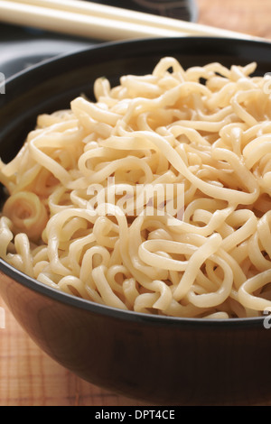 Ramen Noodles in lacquer bowls with chopsticks - Stock Photo