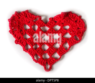 Knitted red heart made of yarn. White isolated - Stock Photo