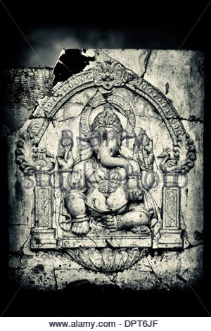 Cracked Lord Ganesha wall plaque in India - Stock Photo