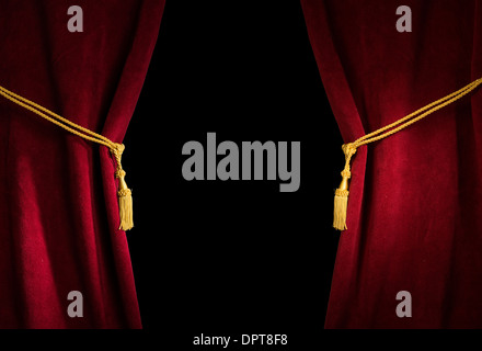 Red velvet curtain with tassel. Close up black isolated curtain - Stock Photo