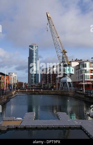 Gunwharf Quays with Dock Crane and No 1 Gunwharf Quays building. - Stock Photo