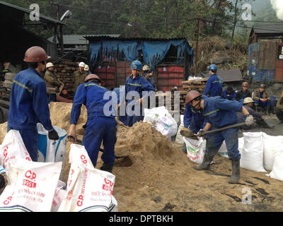 Uong Bi town, Quang Ninh province, Vietnam. 16th Jan, 2014. Rescuers work at the accidental site in Uong Bi town, - Stock Photo