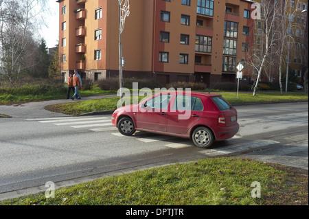 Car driving across a zebra crossing in Nove Zamky Slovakia - Stock Photo