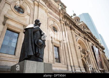 SANTIAGO, Chile - A statue of Chilean cardinal Jose Maria Caro Rodriguez (1866-1958) in Plaza de Armas in front - Stock Photo