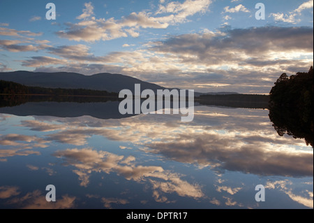 Cloud and Sky reflections on the still waters of Loch Garten, Strathspey Inverness-shire Scotland.  SCO 9214. - Stock Photo