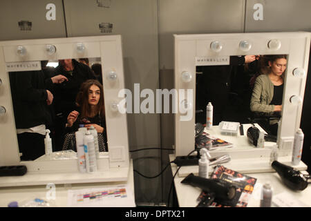 Berlin, Germany. 16th Jan, 2014. Models are prepared backstage prior to the German label HolyGhost's show during - Stock Photo
