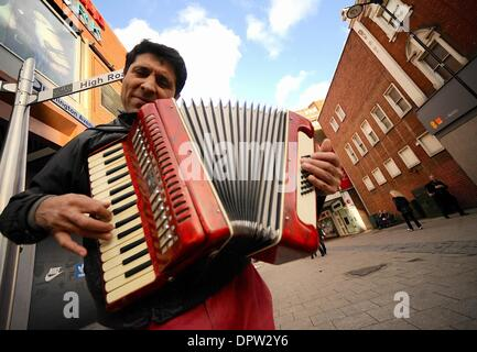 London, UK, UK. 17th Jan, 2014. A Romanian man plays the accordian in North London. As of January 1st Romanians - Stock Photo