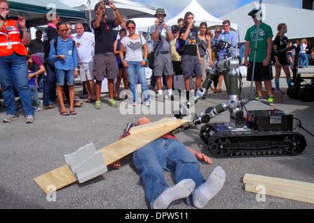 Miami Homestead Florida Speedway DARPA Robotics Challenge Trials exhibit remote controlled robot robots demonstration - Stock Photo