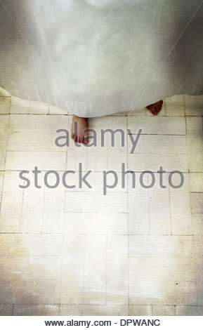 Child Hiding Behind Curtain with Feet Showing - Stock Photo