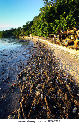 Plastic bottles, bags and other garbage pollute a south coast beach on Bunaken Island, a marine national park of - Stock Photo