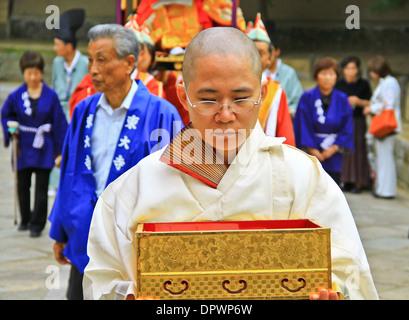 A Buddhist monk carrying a relic box at a procession at Todaiji temple, Nara, Japan. - Stock Photo