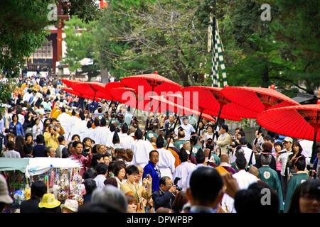 Bright red parasols carried at a Buddhist procession, at Todaiji Temple, Nara - Japan. - Stock Photo