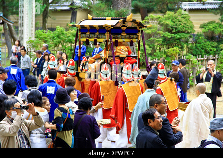 A beautiful sedan, carried at a Buddhist procession, at Todaiji Temple, Nara - Japan. - Stock Photo