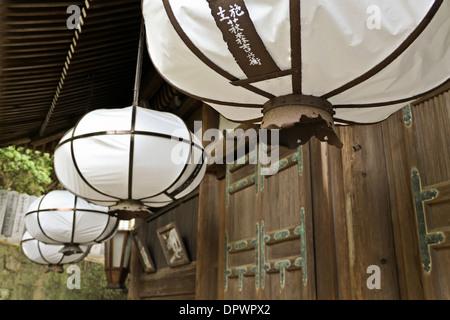 Large paper lanterns hanging at the Sangatsudo Shrine, part of Tōdaiji Temple, Nara, Japan. - Stock Photo