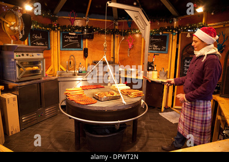 Sausages ( Bratwurst ) being cooked in a stall, Cologne christmas markets, Cologne ( Koln ), Germany Europe - Stock Photo