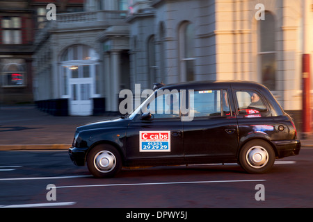 Hackney Cabs, Private Hire Vehicles for hire_ Taxis in Blackpool Town Centre, Lancashire, UK - Stock Photo