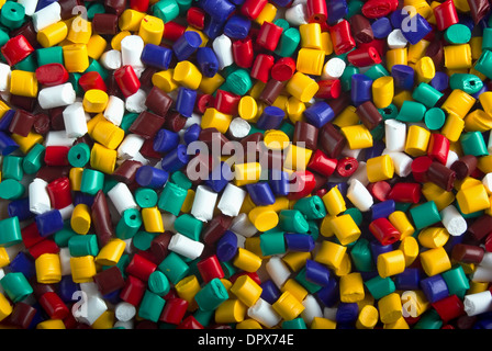 Colorful industrial plastic granules background - Stock Photo