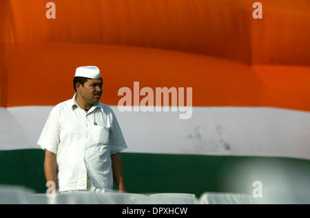 Apr 29, 2009 - New Delhi, NCR (National Capital Region), India - A Congress supporter listens to the speech of party - Stock Photo