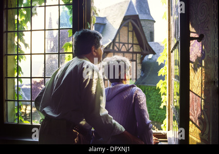 Couple looking out of stained glass window of, Cochem Castle, Cochem, Germany, Europe - Stock Photo