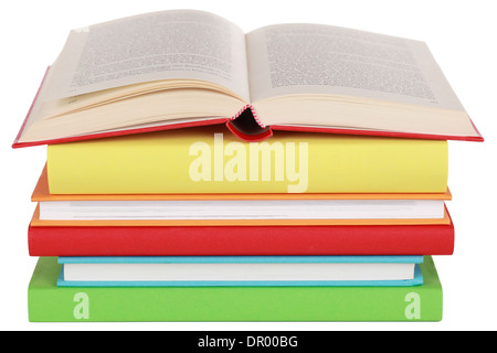 Opened book on a stack, isolated on a white background - Stock Photo