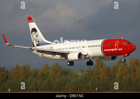 Norwegian Boeing 737-800 with the registration LN-NOM and Greta Garbo on the tail approaches - Stock Photo