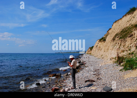 Aero island, Angler at the coast, Fyn, Denmark, Scandinavia, Europe - Stock Photo