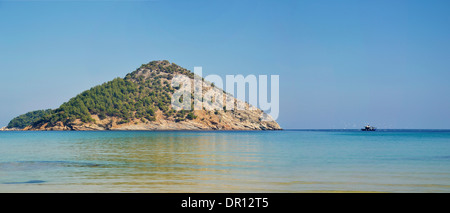 The pure waters of the Mediterranean sea at the Paradise beach on the island of Thassos, Greece - Stock Photo