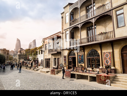 The Old Town (Icheri Sheher) of Baku, Azerbaijan. Flame Towers in the background. - Stock Photo