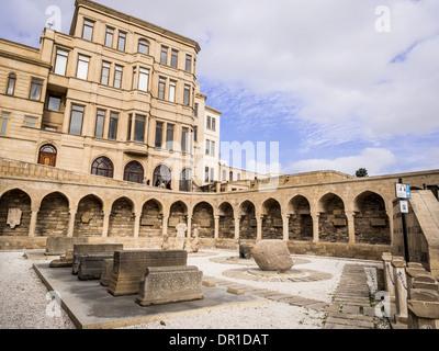 Courtyard with lapidarium in Icheri Sheher (Old Town) of Baku, Azerbaijan. - Stock Photo