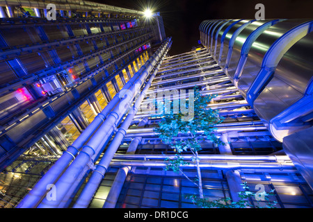 Evening view of the famous Lloyds Building in the City of London, England. - Stock Photo