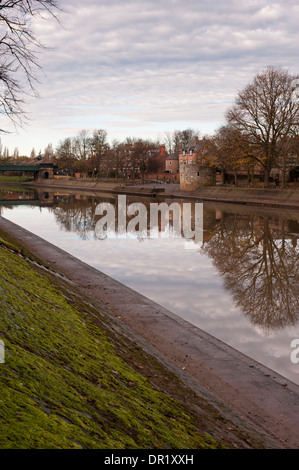 View of River Ouse looking upstream (historic Marygate Water Tower, trees, buildings & clouds in sky reflected in - Stock Photo