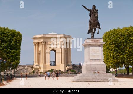 The mounted statue of Louis XIV and Chateau d'Eau, Place Royale du Peyrou, Montpellier, Hérault, Languedoc-Roussillon, - Stock Photo