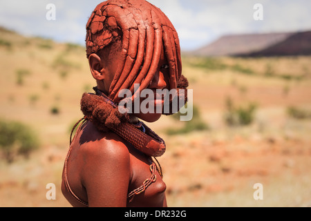 Portrait of Himba woman whose mud caked hairstyle covers most of her face in Damaraland Namibia Africa - Stock Photo