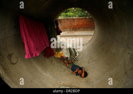 Jan. 12, 2009 - Amhedabad, India - A young boy sleeps in a concrete pipes on the side of the road in Amhedabad. - Stock Photo