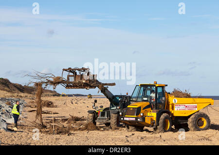 Norfolk, UK. 17th Jan, 2014. Debris washed up on Norfolk beaches from the December 2013 tidal surge being cleared - Stock Photo