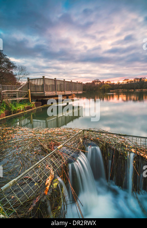 Small waterfall at Burton Mill Pond, West Sussex, UK - Stock Photo