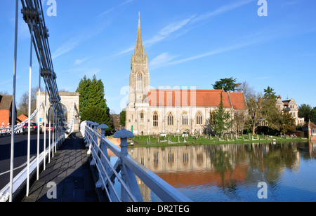 Bucks - Marlow on Thames - on suspension bridge - view along walkway to riverside All Saints - sunlight blue sky - Stock Photo