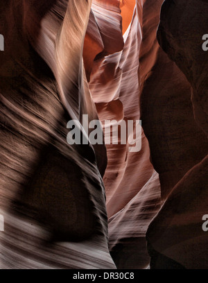 Lower Antelope Canyon slot canyon near Page, Arizona showing the play of light and shadows on the eroded sandstone - Stock Photo
