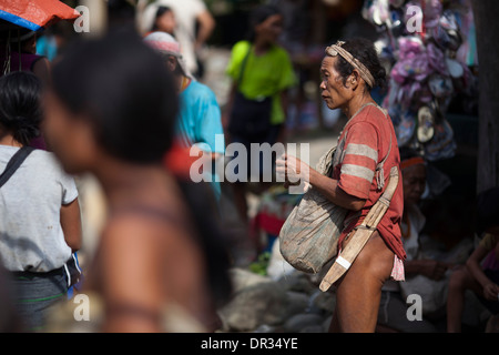 A Hanunoo Mangyan man at a Mangyan market near Mansalay, Oriental Mindoro, Philippines. - Stock Photo
