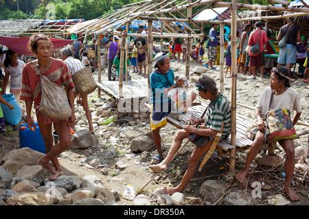 Hanunoo Mangyan men at a Mangyan market near Mansalay, Oriental Mindoro, Philippines. - Stock Photo