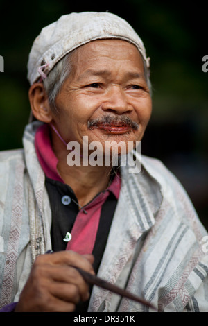 A Hanunoo Mangyan man with red-stained mouth, the telltale sign of chewing betel, or nga nga, in Oriental Mindoro, - Stock Photo