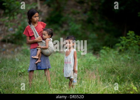 Mangyan children wait for their family members at a Mangyan market near Mansalay, Oriental Mindoro, Philippines. - Stock Photo