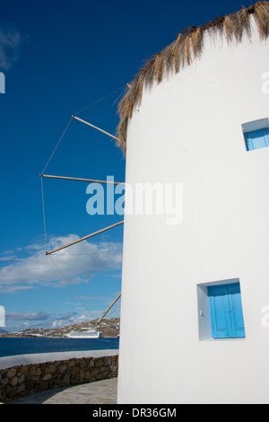Greece, Cyclades group of islands, Mykonos, Hora. Historic 16th century Cycladic style windmill. Cruise ship in - Stock Photo