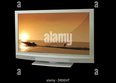 tv with sunset background - Stock Photo