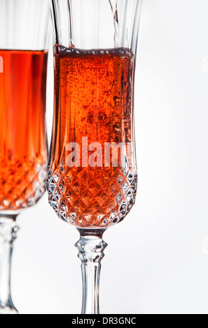 Two crystal glasses with pink champagne - Stock Photo