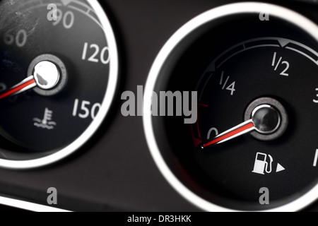 Coolant temperature and fuel level gauges on a car's dashboard - Stock Photo